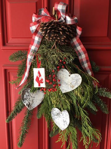 Festive Forest by Penny Spool Quilts - Christmas Tree Ornament Tutorial- showing the ornament hanging from a door swag decorated with birch hearts and plaid ribbon