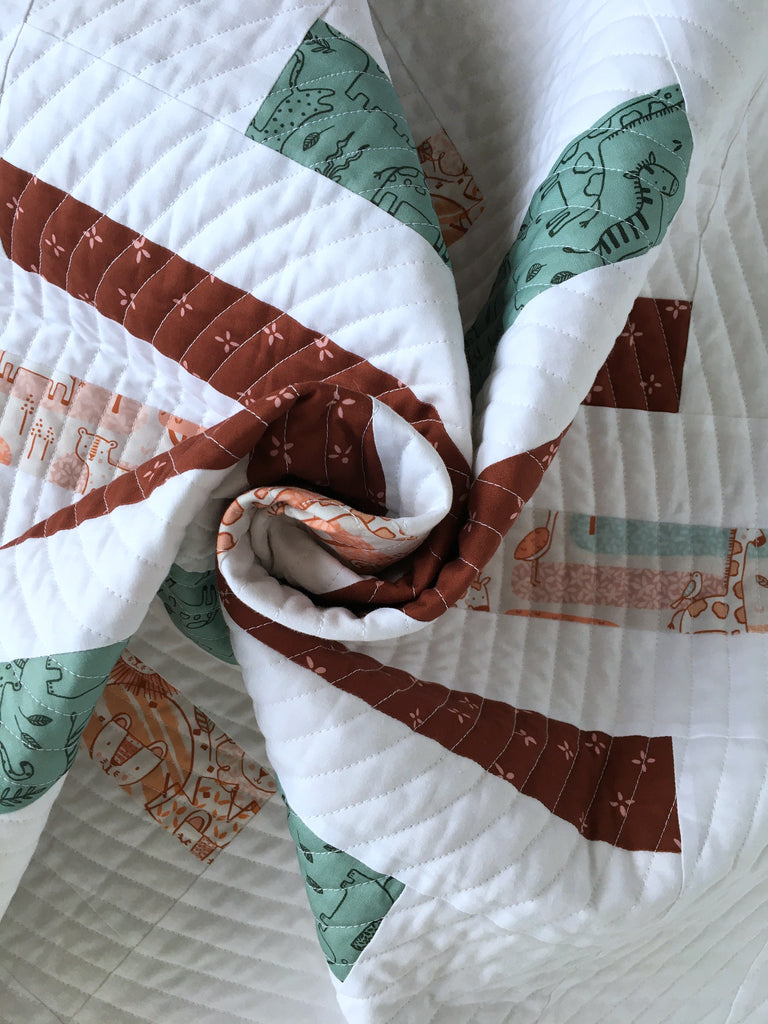 spinning top quilt pattern by penny spool quilts, baby quilt in figo fabrics savanna sunset