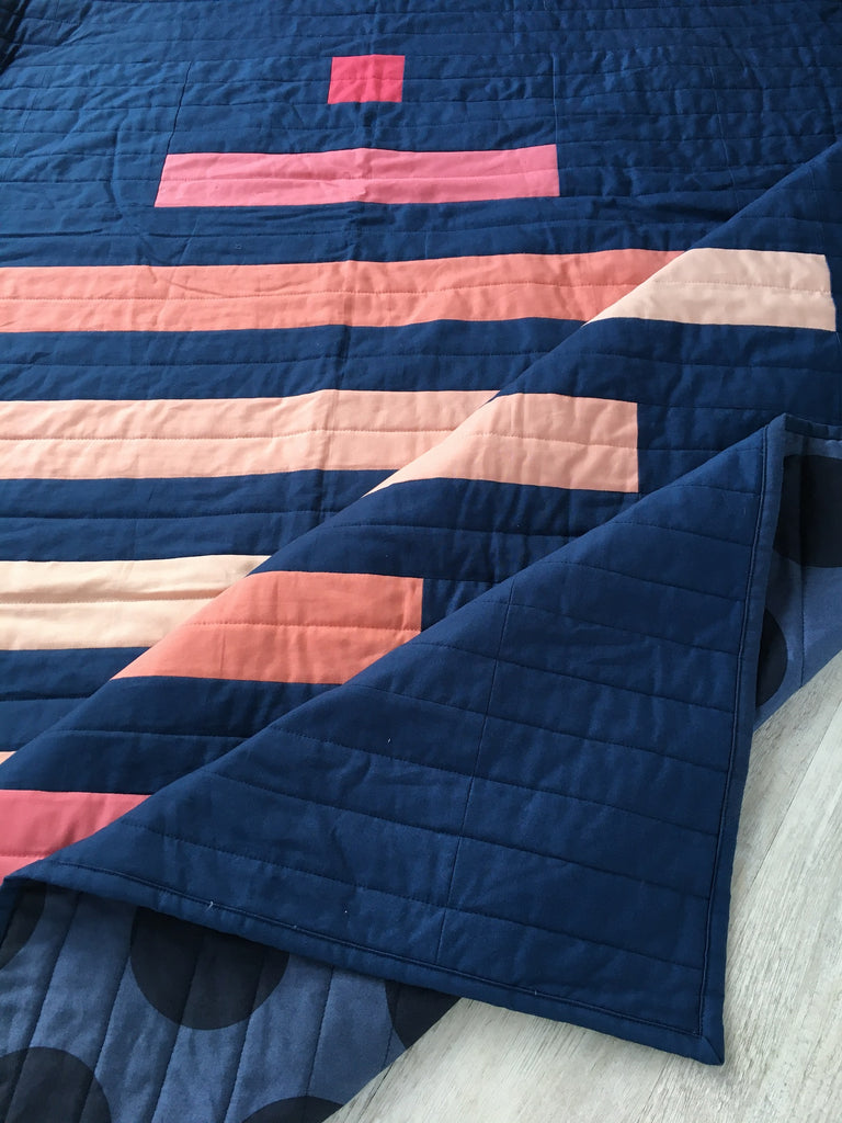 spinning top quilt pattern by penny spool quilt, pink ombre on navy