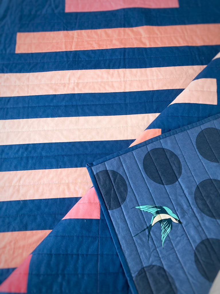 spinning top quilt pattern by penny spool quilts, pink ombre on navy