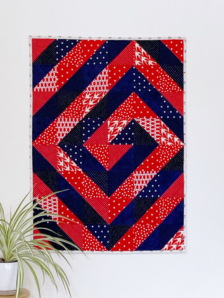 Ripple and Swirl Quilt pattern by Penny Spool Quilts, red and navy baby quilt