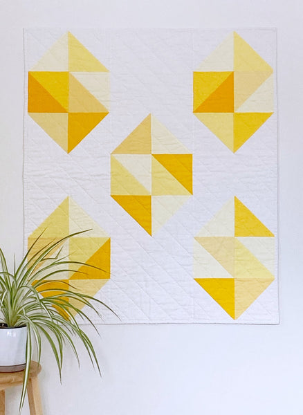 Facets modern gemstone quilt pattern by Monika Henry of Penny Spool Quilts - Quilt featuring modern, simplified yellow gemstones on white background.