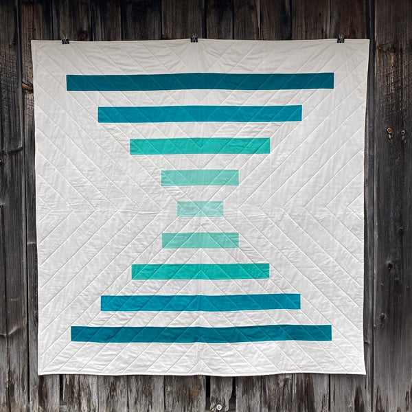 Raise The Bar modern quilt pattern by Penny Spool Quilts - beginner-friendly courthouse steps big block quilt in turquoise ombre