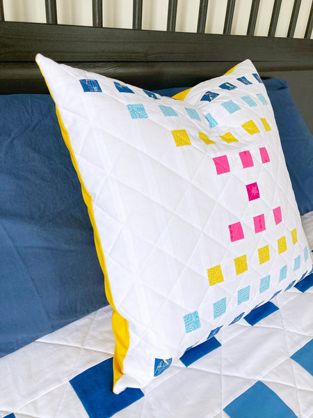 Staccato Quilt pattern by Monika Henry of Penny Spool Quilts - modern geometric quilt pattern - multi-coloured pillow