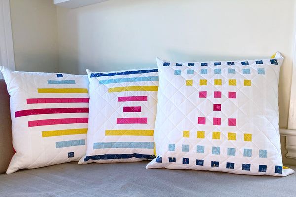 Staccato Quilt pattern by Monika Henry of Penny Spool Quilts - modern geometric quilt pattern - bright multi-coloured pillow