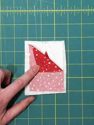 Festive Forest by Penny Spool Quilts - Christmas Tree Ornament Tutorial - quilted block with backing fabric on top, ready to sew together