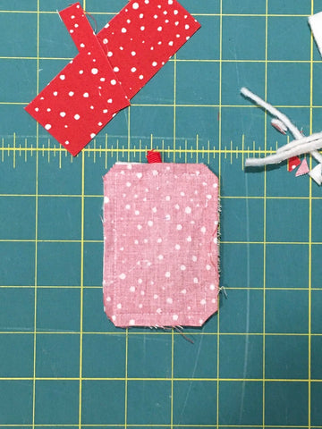 Festive Forest by Penny Spool Quilts - Christmas Tree Ornament Tutorial - finished block with backing sewn on and ribbon ends poking out from the top. still inside out, ready to be turned