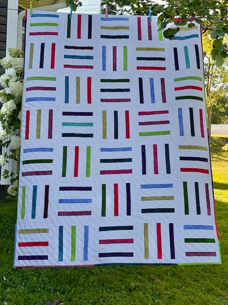 Bar Code quilt pattern by Penny Spool Quilts - tester quilt by Mercedes in scrappy with white background