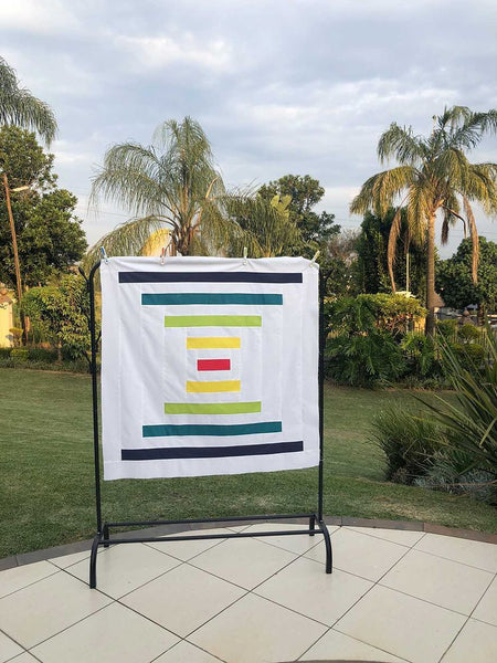 Raise The Bar beginner-friendly modern big block quilt pattern, courthouse steps quilt pattern by Penny Spool Quilts