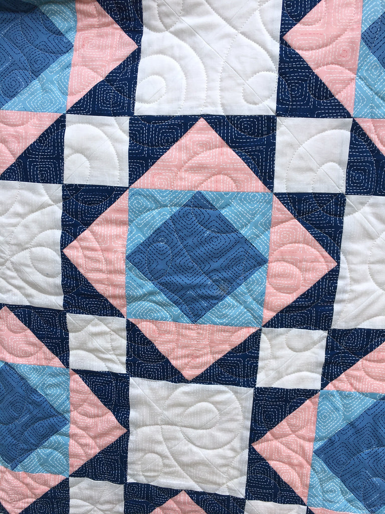 Victorian Tiles Quilt Pattern by Penny Spool Quilts - detail shot of one block of the sample quilt, blue and pink geometric design