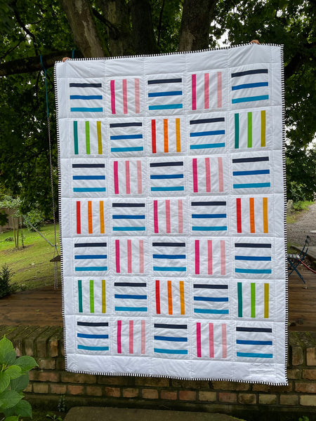 Bar Code Quilt pattern by Monika Henry of Penny Spool Quilts - tester quilt by Viky Kuhn in white with multicoloured stripes