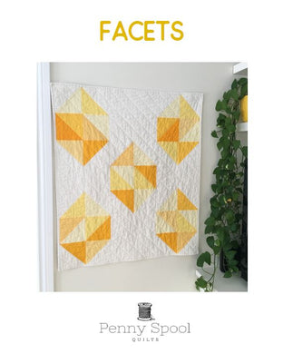 Facets quilt pattern by Penny Spool Quilts. Cover page of pattern showing quilt with yellow large scale gemstones on white background.