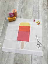 Load image into Gallery viewer, Popsicle 1 quilt block pattern by Penny Spool Quilts. Part of the Ice Cream Sunday collection. Tri-coloured popsicle in yellow, orange and pink solid fabrics on white background. shown with spools of thread, clips and scissors