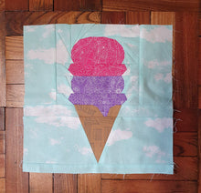 Load image into Gallery viewer, Ice Cream Cone quilt block pattern by Penny Spool Quilts. Part of the Ice Cream Sunday collection. Light brown wafer cone with one scoop of purple ice cream and one scoop of pink ice cream, on light blue background.