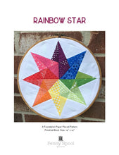 Load image into Gallery viewer, Rainbow Star Quilt Block Pattern by Penny Spool Quilts. Pattern cover showing eight pointed star made with rainbow of print fabrics on white background, displayed in embroidery hoop on red brick wall.
