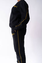 Load image into Gallery viewer, Side view of Black Crewneck and Black Sweatpants worn on model