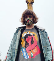 Charcoal version of the Lockdown Royalty t-shirt by a model wearing a mask in an urban setting