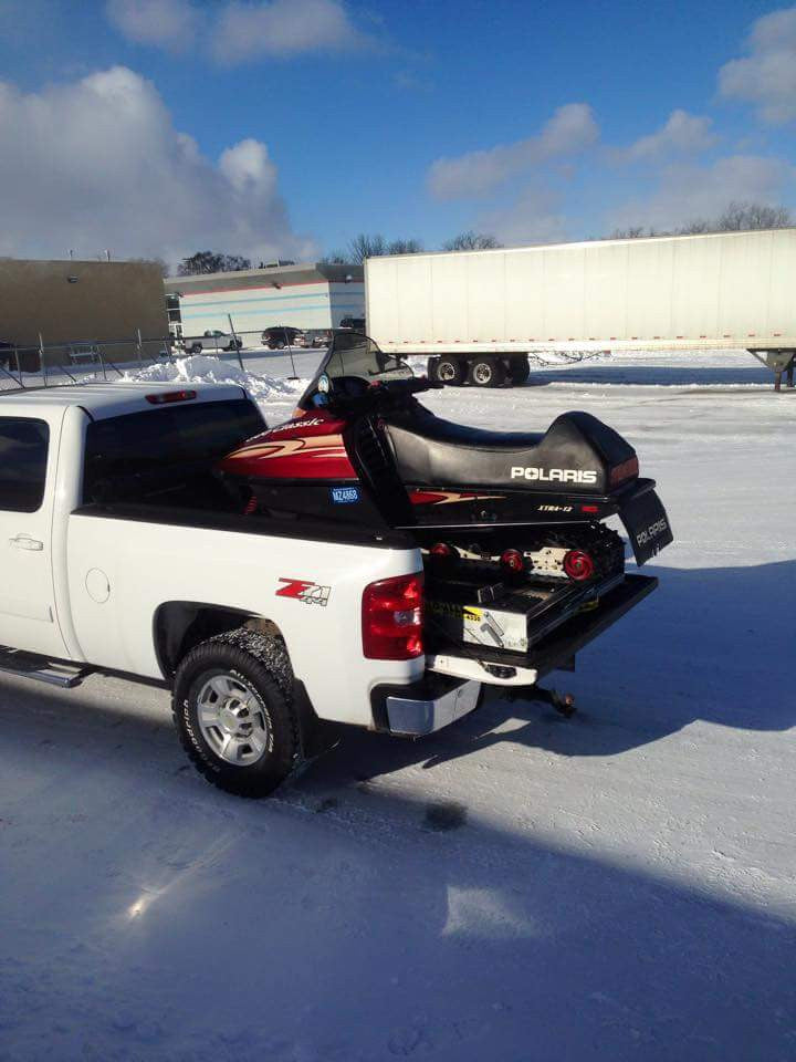 PAUL loading his snowmobile with his loadall v3 ramp
