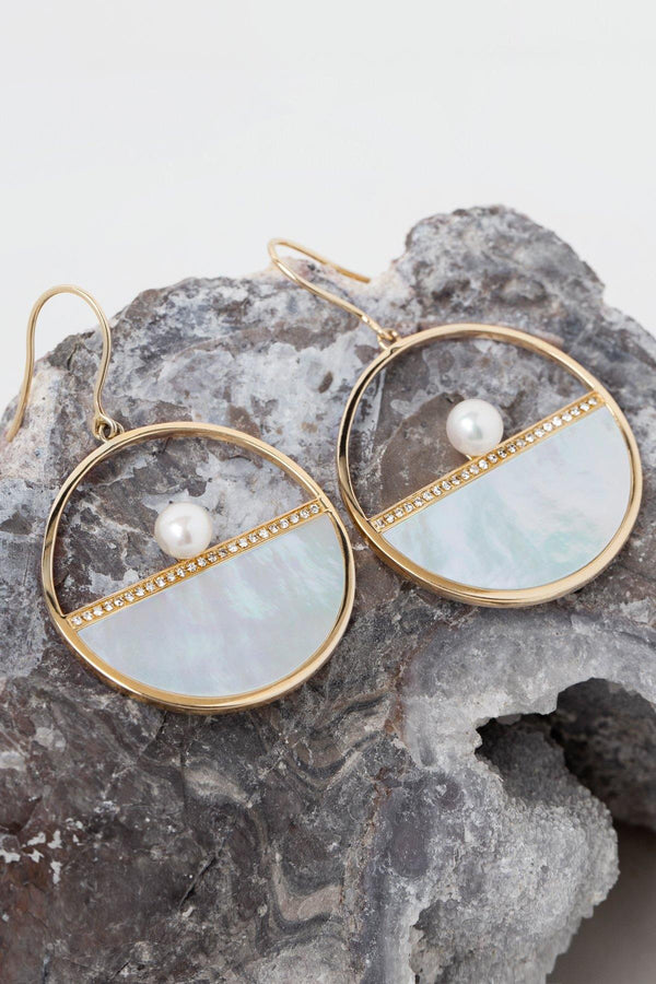 Bella 14K solid gold hoops on rock