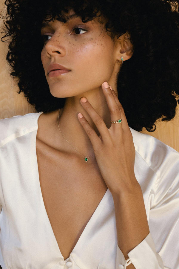 Jayden - NAiiA - 14K solid gold pave diamond halo pear shaped emerald necklace on gold chain on model