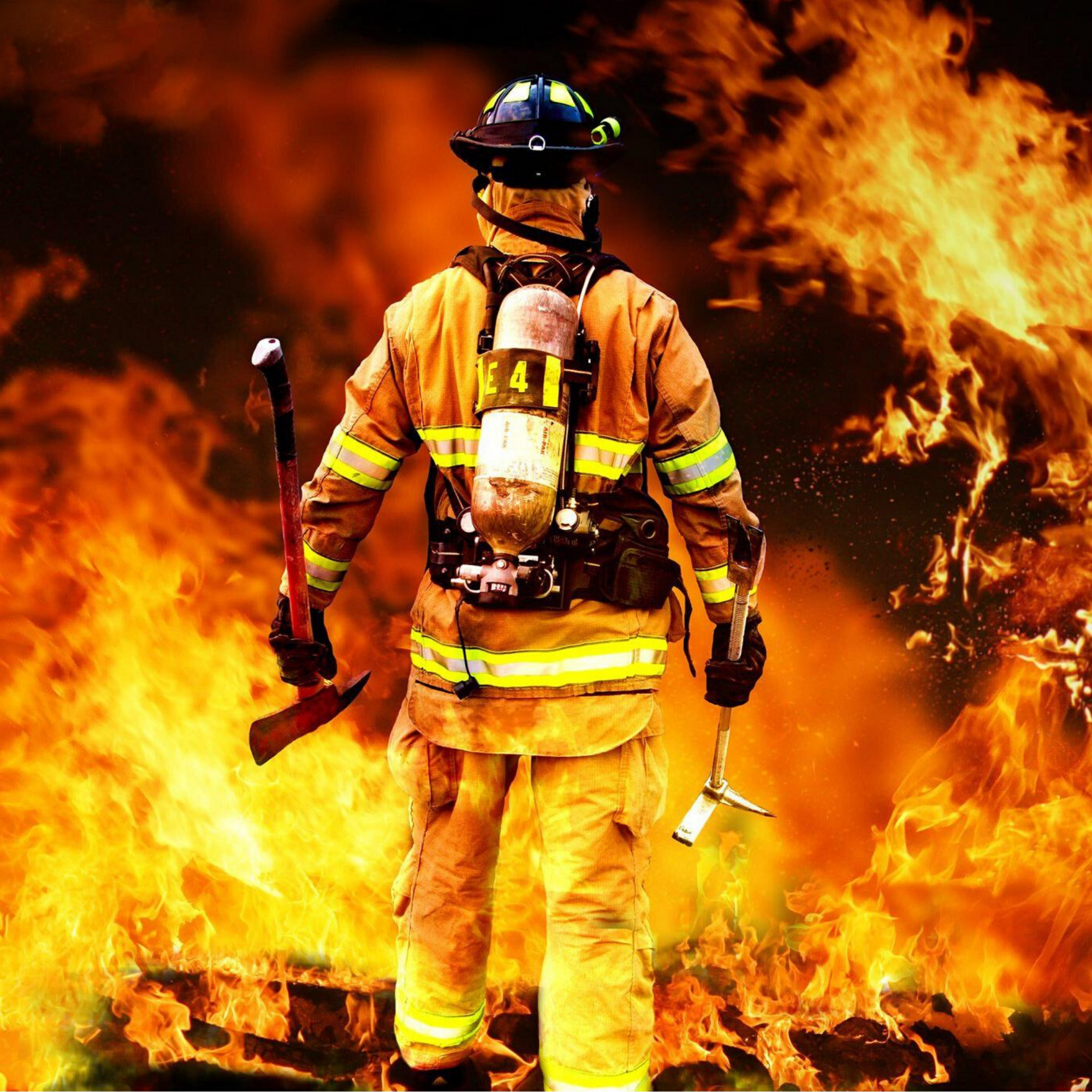 Fireman in front of fire