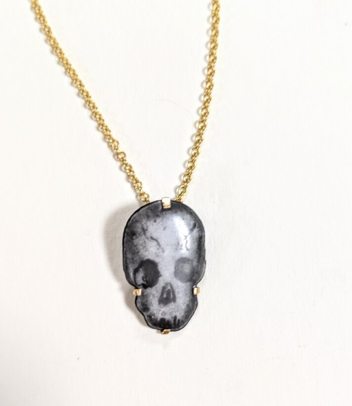 Skull pendant with gold