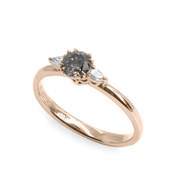 gold engagement ring with grey diamond