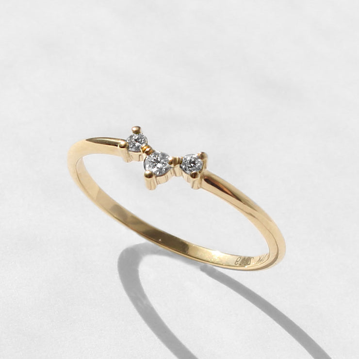 gold ring with three white diamonds