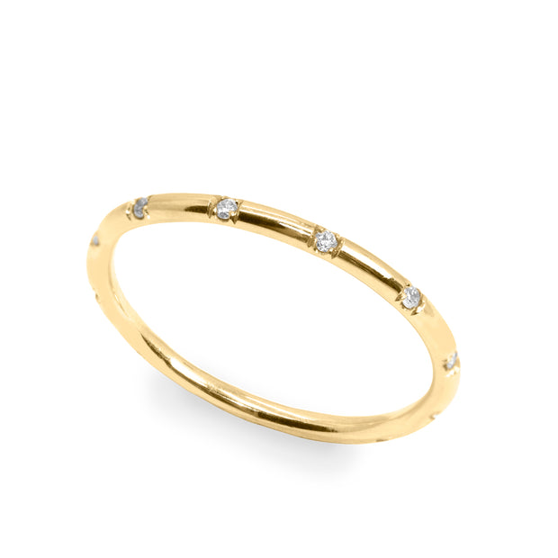 thin gold wedding band with diamonds