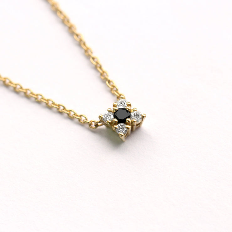 gold necklace with flower of diamonds