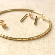 gold bangle with white diamonds
