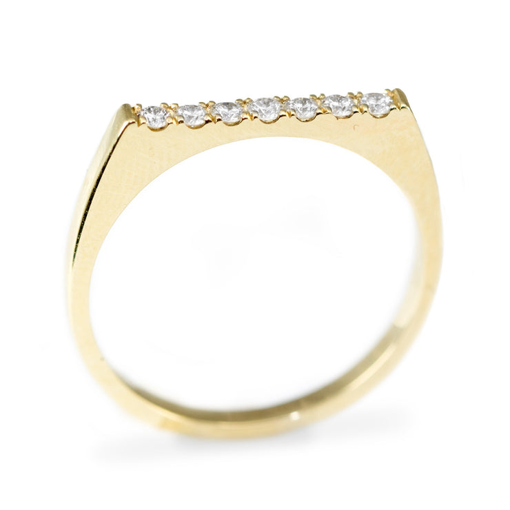 row of diamonds on gold ring