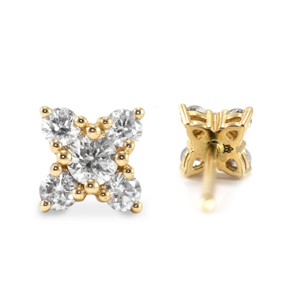 five white diamonds on gold earrings