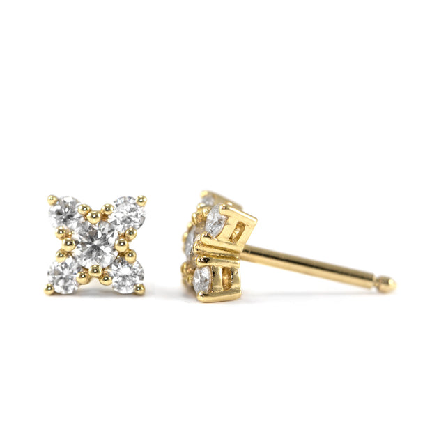 gold stud earrings with five white diamonds