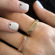 gold ring with 12 white diamonds