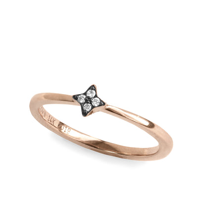 rose gold star shaped ring with diamonds