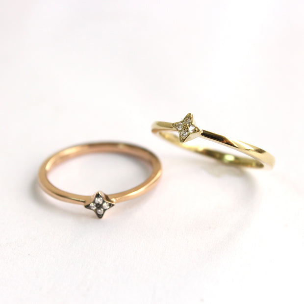 star shaped rose gold ring with four diamonds