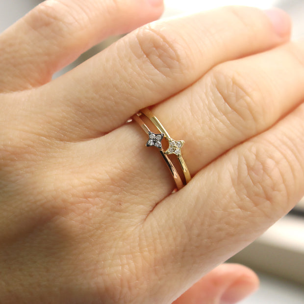 rose gold ring with a star and white diamonds