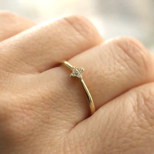 Four white diamond star ring