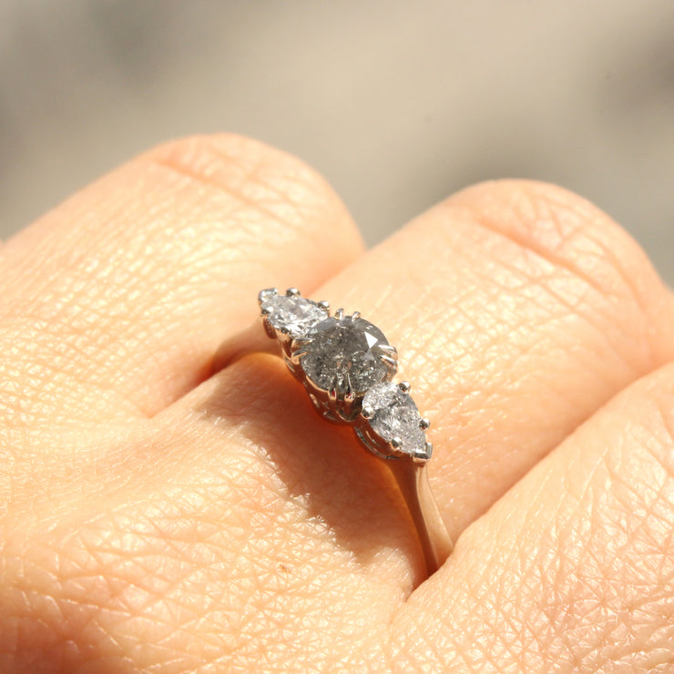 white gold engagement ring with gray diamond