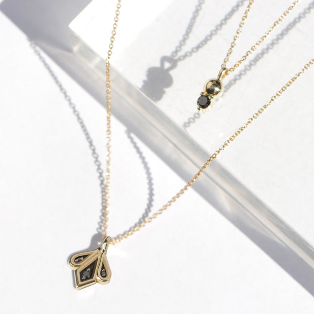 gold and black diamond necklace marie