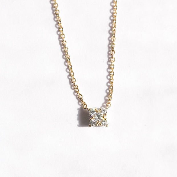 gold necklace with five round diamonds