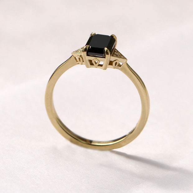 gold ring with emerald cut diamond