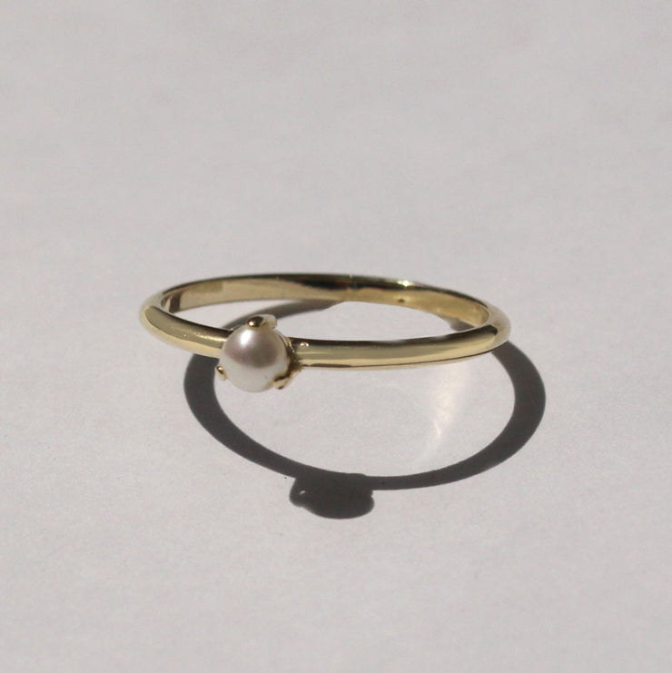 delicate gold ring with pearl
