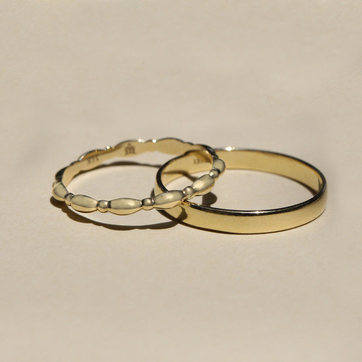 Gold curvy wedding band
