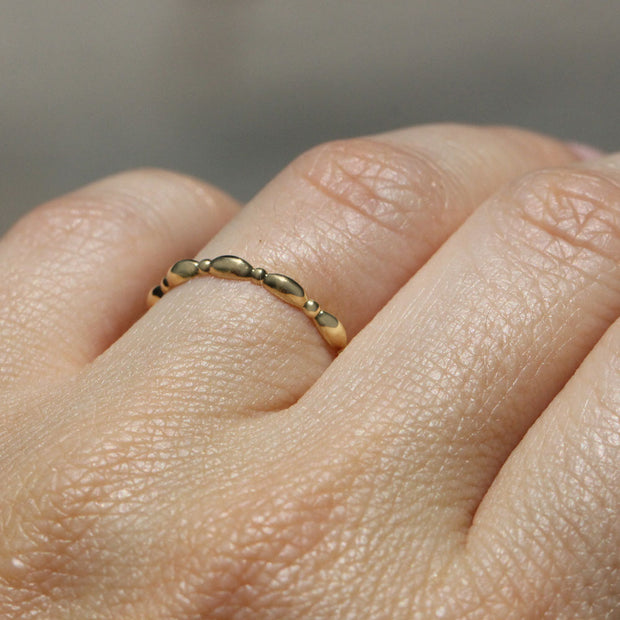 curvy gold wedding band