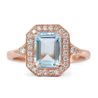 large aquamarine and 28 diamond halo