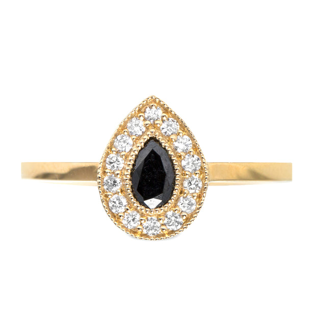 pear shaped black diamond on a ring