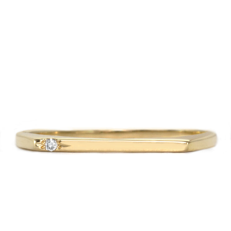 thin gold ring with one diamond