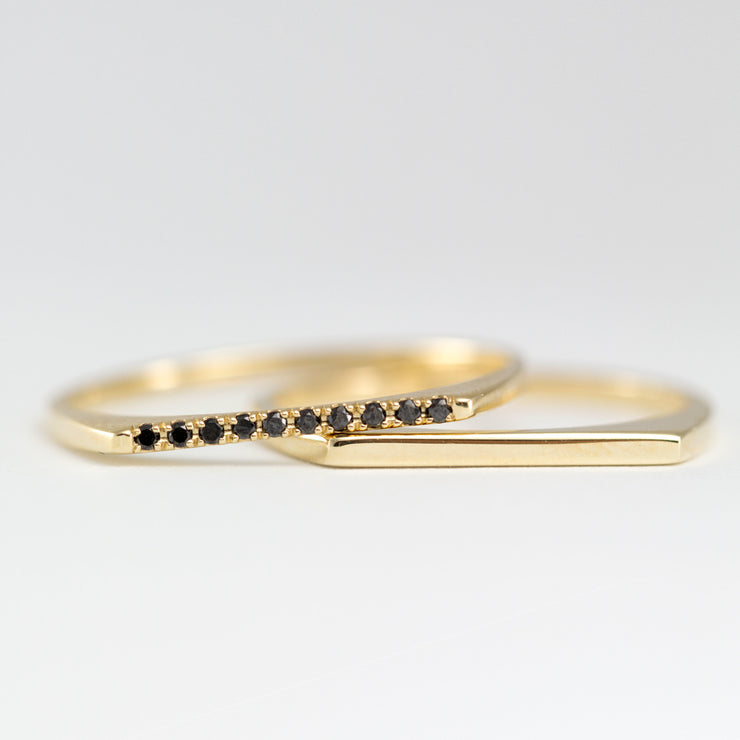 thin gold ring with 10 black diamonds